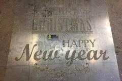 Фотография вырезанного трафарета С Новым годом